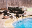synergy custom pool natural stone diving rock